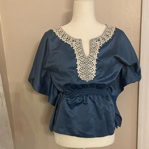 Blue blouse with lace detail